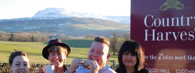 Shop floor manager Steve West enjoying a bacon butty with some of the team at Country Harvest